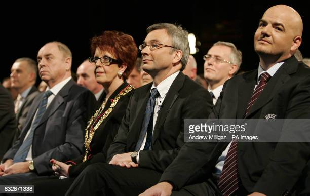 Scottish FA Chief Executive David Taylor sits beside Glasgow Provost Liz Cameron and acting UEFA Chief Executive Gianni Infantino during the UEFA Cup...