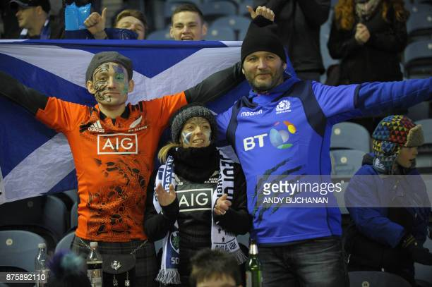 Scottish fans cheer after the international rugby union test match between Scotland and New Zealand at Murrayfield stadium in Edinburgh on November...