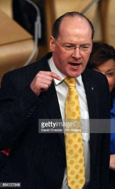Scottish Finance minister John Swinney talks to the Scottish Parliament during the debate on the budget in Edinburgh