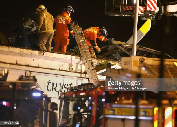 Scottish Fire and Rescue firefighters and USAR teams at the scene of a helicopter crash at the Clutha Bar in Glasgow