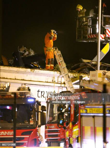 Scottish Fire and Rescue USAR teams at the scene of a helicopter crash at the Clutha Bar in Glasgow