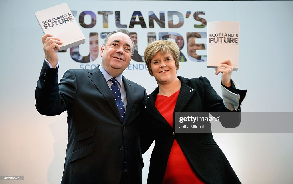 Scottish First Minister <a gi-track='captionPersonalityLinkClicked' href=/galleries/search?phrase=Alex+Salmond&family=editorial&specificpeople=857688 ng-click='$event.stopPropagation()'>Alex Salmond</a> (L) and Deputy First Minister <a gi-track='captionPersonalityLinkClicked' href=/galleries/search?phrase=Nicola+Sturgeon&family=editorial&specificpeople=2582617 ng-click='$event.stopPropagation()'>Nicola Sturgeon</a> present the White Paper for Scottish independance at the Science Museum Glasgow on November 26, 2013 in Glasgow, Scotland. The 670 page document details plans for an independent Scotland, covering proposals for currency, EU membership and defense amongst other topics. The paper, entitled 'Scotland's future: Your guide to an independent Scotland' is launched ahead of the referendum for independence, which will take place on 18 September, 2014, and may see Scotland splitting from the rest of the United Kingdom.