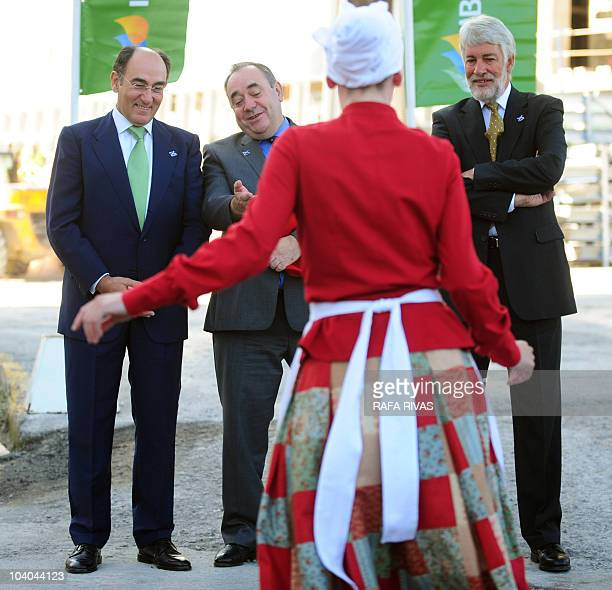 Scottish First Minister Alex Salmond and President of Iberdrola power company Ignacio Galan look at a Basque dancer performing in front of the new...