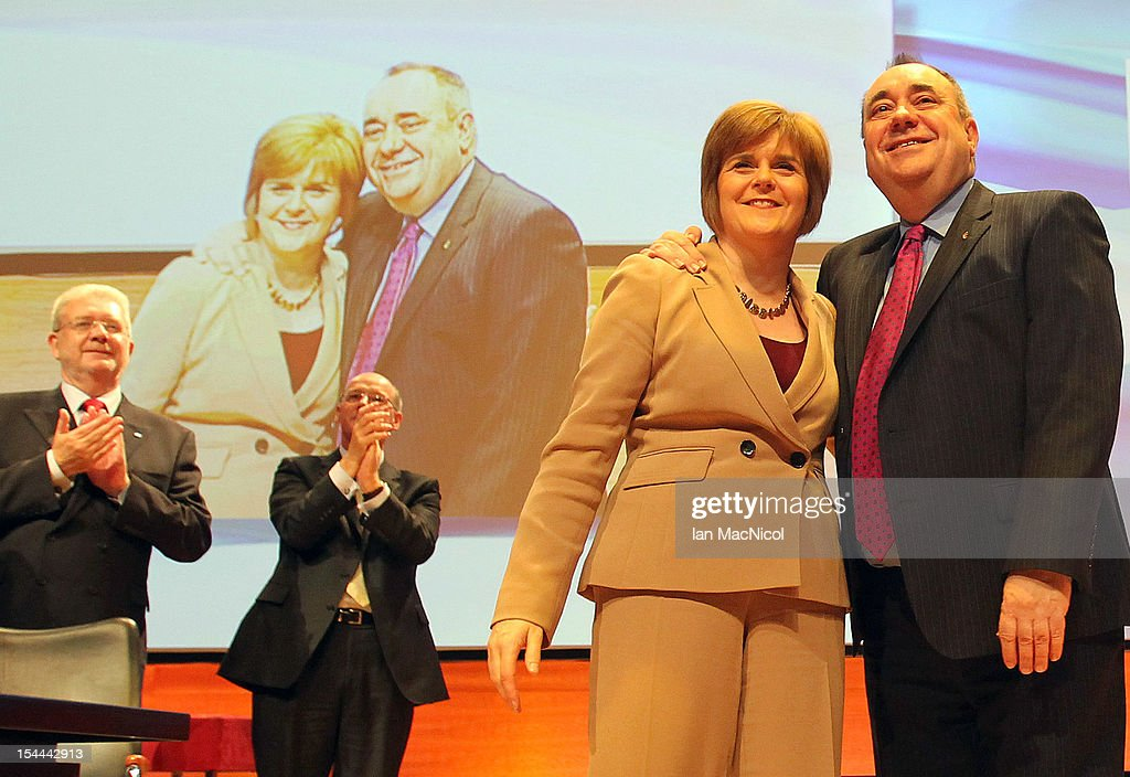 Scottish First Minister <a gi-track='captionPersonalityLinkClicked' href=/galleries/search?phrase=Alex+Salmond&family=editorial&specificpeople=857688 ng-click='$event.stopPropagation()'>Alex Salmond</a> is joined on stage by Deputy <a gi-track='captionPersonalityLinkClicked' href=/galleries/search?phrase=Nicola+Sturgeon&family=editorial&specificpeople=2582617 ng-click='$event.stopPropagation()'>Nicola Sturgeon</a> after he spoke at The SNP Annual Conference on October 20, 2012 in Perth, Scotland. The First Minister delivered his key note speech today after signing a deal with David Cameron earlier in the week for Scotland's referendum to take place in the autumn of 2014.