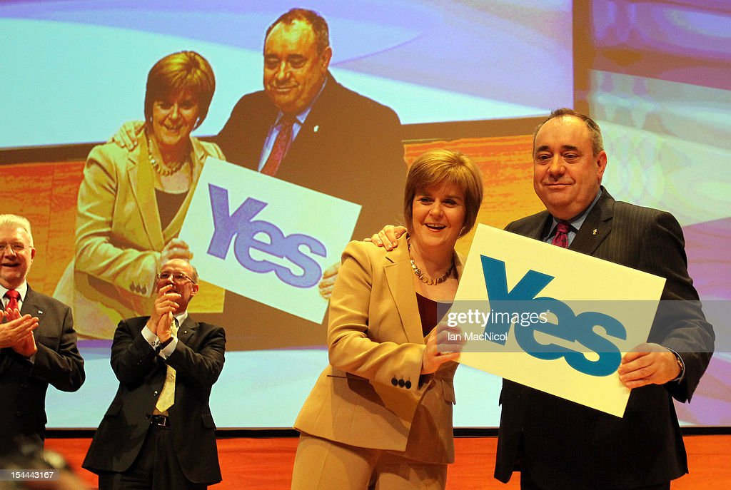 Scottish First Minister Alex Salmond is joined on stage by Deputy Nicola Sturgeon after he spoke at The SNP Annual Conference on October 20, 2012 in Perth, Scotland. The First Minister delivered his key note speech today after signing a deal with David Cameron earlier in the week for Scotland's referendum to take place in the autumn of 2014.