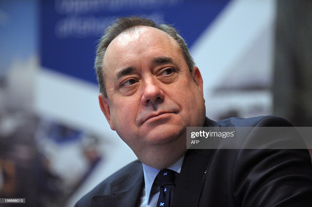 Scottish First Minister Alex Salmond listens to head of French energy giant Areva, on November 19, 2012 in Paris, after Areva group and Scottish Enterprise, a sponsored non-departmental public body of the Scottish government encouraging economic development, signed a memorandum of understanding on industrial site development for the manufacture of wind turbines in East Scotland. AFP PHOTO / ERIC PIERMONT