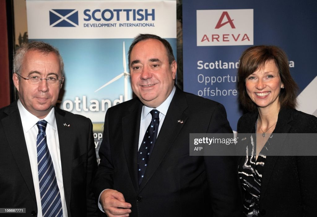 Scottish First Minister Alex Salmond (C) poses with head of French energy giant Areva Luc Oursel and Scottish Enterprise Chief Executive Lena Wilson on November 19, 2012 in Paris, after Areva group and Scottish Enterprise signed a memorandum of understanding on industrial site development for the manufacture of wind turbines in East Scotland.