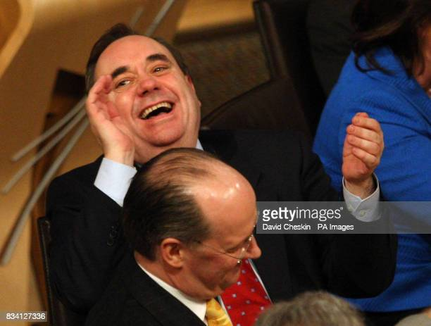 Scottish First Minister Alex Salmond with Finance Minister John Swinney at the Scottish Parliament during the debate on the budget in Edinburgh