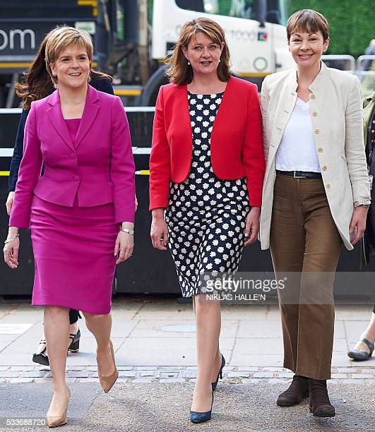 Scottish First Minister and Leader of the SNP Nicola Sturgeon walks with Plaid Cymru leader Leanne Wood and former leader of The Green Party Caroline...