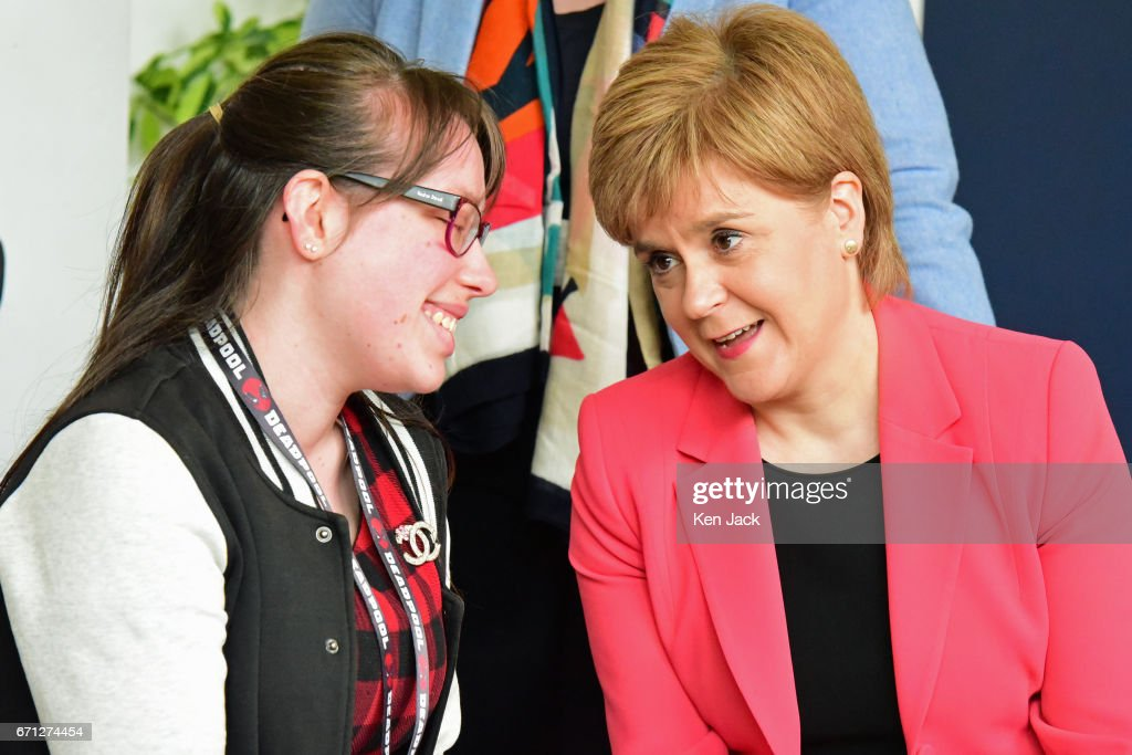 Scottish First Minister and SNP leader Nicola Sturgeon chats to a centre user as she launches the party's manifesto for the local government elections campaign at WHALE community arts centre, on April 21, 2017 in Edinburgh, Scotland. Local elections are scheduled to take place on Thursday May 4 across all local authorities.
