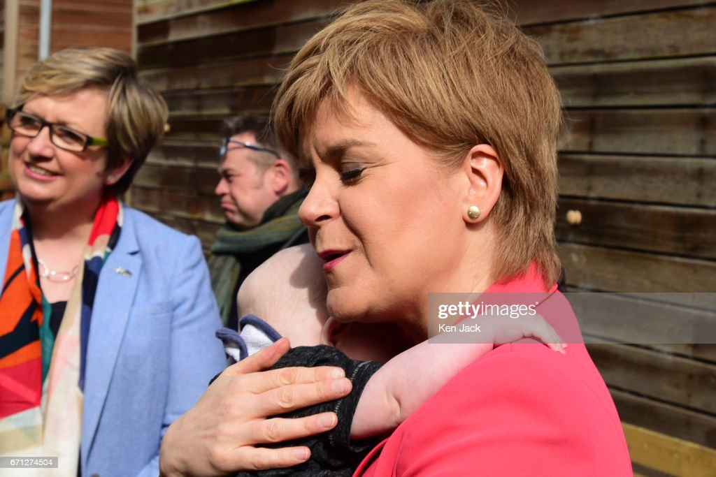 Scottish First Minister and SNP leader Nicola Sturgeon cuddles six-month old Ollie Lynch from Edinburgh, as she launches the party's manifesto for the local government elections campaign at WHALE community arts centre, on April 21, 2017 in Edinburgh, Scotland. Local elections are scheduled to take place on Thursday May 4 across all local authorities.