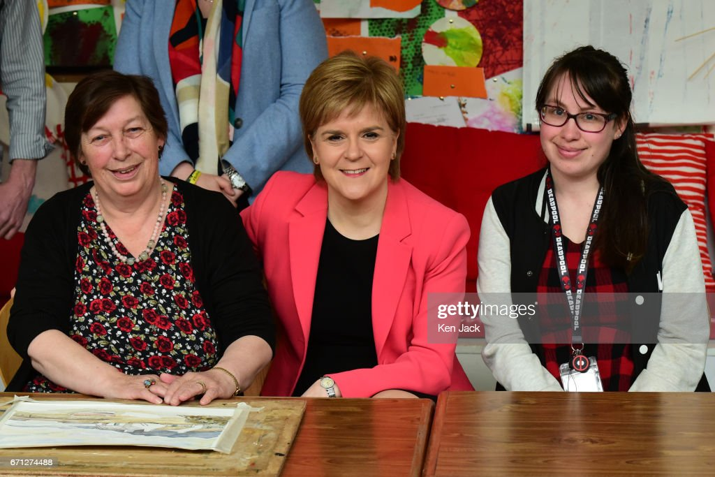 Scottish First Minister and SNP leader Nicola Sturgeon poses with centre users as she launches the party's manifesto for the local government elections campaign at WHALE community arts centre, on April 21, 2017 in Edinburgh, Scotland. Local elections are scheduled to take place on Thursday May 4 across all local authorities.