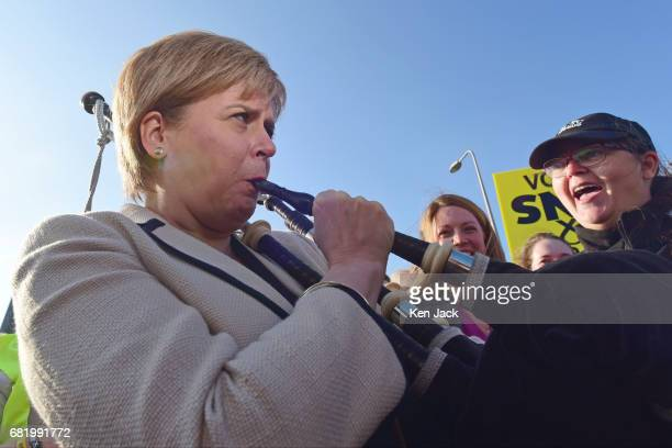 Scottish First Minister and SNP leader Nicola Sturgeon tries her hand at the bagpipes on a campaign walkabout in the North East Fife parliamentary...