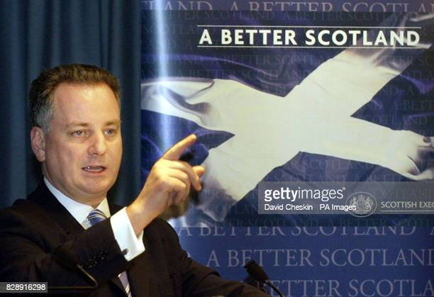 Scottish First minister Jack McConnell taking questions at a press conference in Edinburgh after Douglas Keil general secretary of the Scottish...