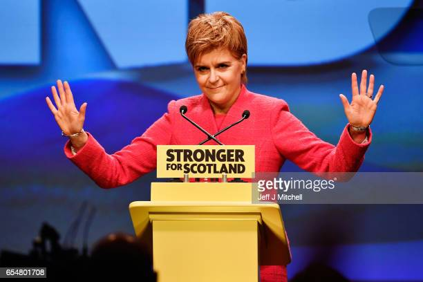 Scottish First Minister Nicola Sturgeon acknowledges the audience as she prepares to deliver her keynote speech at the SNP spring conference on March...