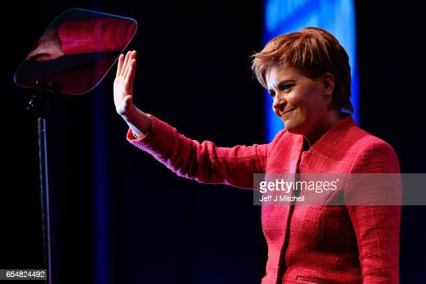 Scottish First Minister Nicola Sturgeon acknowledges the audience following her keynote speech at the SNP spring conference on March 18 2017 in...