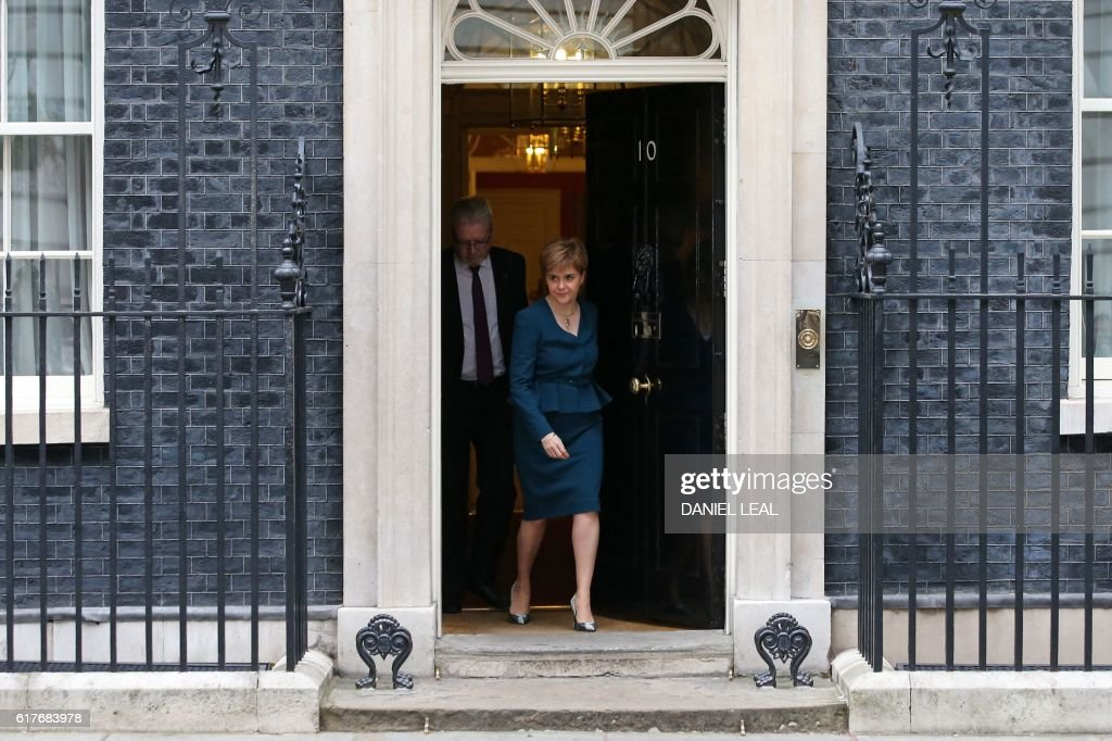 Scottish First Minister Nicola Sturgeon (R) and Scottish Brexit minister Michael Russell leave 10 Downing Street in central London on October 24, 2016 after holding talks with British Prime Minister Theresa May and the first ministers of Wales and Northern Ireland on the government's Brexit plans. Sturgeon, leader of the secessionist Scottish National Party, has been the most vocal of the first ministers since the June 23 vote. Earlier this month she called for a fresh referendum on Scottish independence if Scotland's interests are not protected in the Brexit negotiations. / AFP / DANIEL