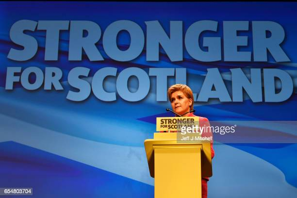 Scottish First Minister Nicola Sturgeon delivers her keynote speech at the SNP spring conference on March 18 2017 in Aberdeeen Scotland Party members...