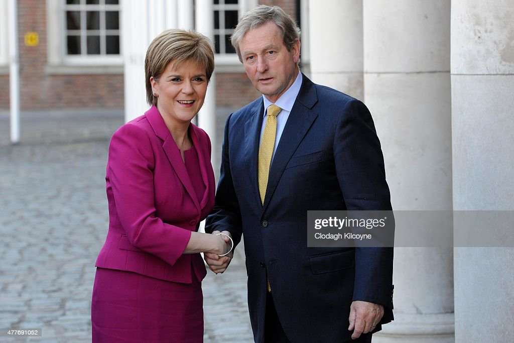 Scottish First Minister <a gi-track='captionPersonalityLinkClicked' href=/galleries/search?phrase=Nicola+Sturgeon&family=editorial&specificpeople=2582617 ng-click='$event.stopPropagation()'>Nicola Sturgeon</a> greets Irish Taoiseach <a gi-track='captionPersonalityLinkClicked' href=/galleries/search?phrase=Enda+Kenny&family=editorial&specificpeople=5129605 ng-click='$event.stopPropagation()'>Enda Kenny</a> at the 24th British-Irish Council (BIC) Summit at Dublin Castle on June 19, 2015 in Dublin, Ireland. The Council are meeting to discuss the continuing improving economic situation in Member Administrations, recognising the interdependence and links between their economies. The Council will also discuss the misuse of alcohol, focusing on the economic and social implications of alcohol abuse and the various measures planned to tackle the problem of excessive alcohol consumption.