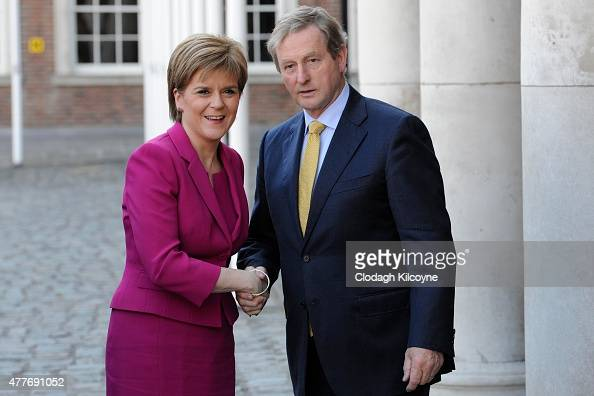 Scottish First Minister Nicola Sturgeon greets Irish Taoiseach Enda Kenny at the 24th BritishIrish Council Summit at Dublin Castle on June 19 2015 in...