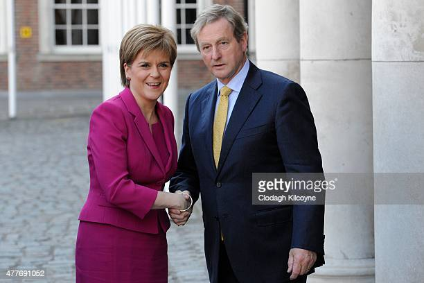 Scottish First Minister Nicola Sturgeon greets Irish Taoiseach Enda Kenny at the 24th BritishIrish Council Summit at Dublin Castle on June 19 2015 in...