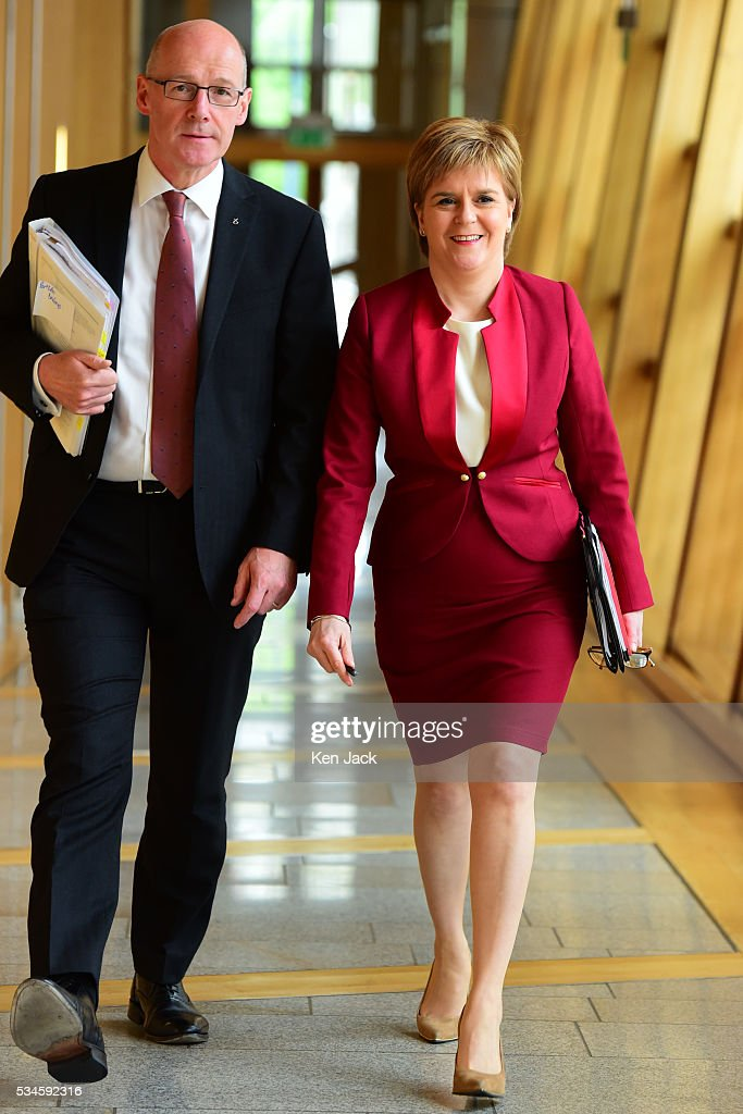 Scottish First Minister Nicola Sturgeon on her way to the chamber of the Scottish Parliament to make a statement on her Government's policy programme for the next five years, accompanied by her deputy John Swinney,