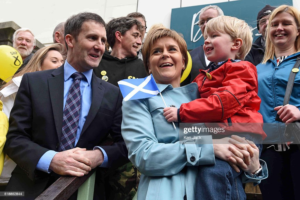 Scottish First Minister <a gi-track='captionPersonalityLinkClicked' href=/galleries/search?phrase=Nicola+Sturgeon&family=editorial&specificpeople=2582617 ng-click='$event.stopPropagation()'>Nicola Sturgeon</a> poses for a photograph with John Clark (4) from Dunipace, and local candidate Michael Matheson as she campaigns in Falkirk for the Scottish Parliament elections which take place on May 5th,
