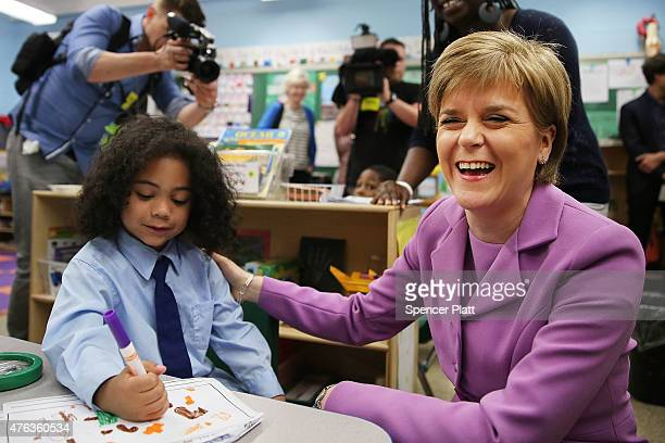 Scottish First Minister Nicola Sturgeon sits with students while visiting a school in Brooklyn at the start of a four day trip to the United States...
