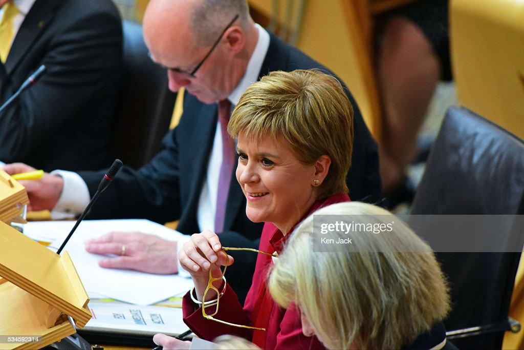 Scottish First Minister Nicola Sturgeon smiles in amusement at opposition comments, after making a statement to the Scottish Parliament on her Government's policy programme for the next five years,