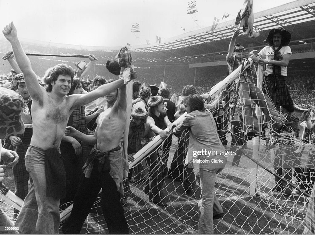 Scottish football fans, known as the Tartan Army, invading the pitch and pulling down goalposts after Scotland beat England 2-1 at Wembley Stadium. Matches between the two sides have always been a matter of great national importance and used to be a regular fixture, eagerly anticipated by both sets of fans.