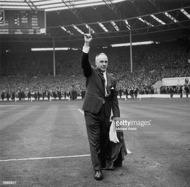 Scottish football manager Bill Shankly at Wembley Stadium north London as manager of Liverpool Football Club He is celebrating his team's 21 win over...