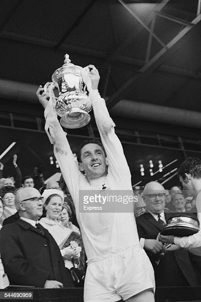 Scottish football player Dave Mackay of Tottenham Hotspur FC lifting the FA Cup after his side defeat Chelsea 21 Wembley Stadium London 20th May 1967