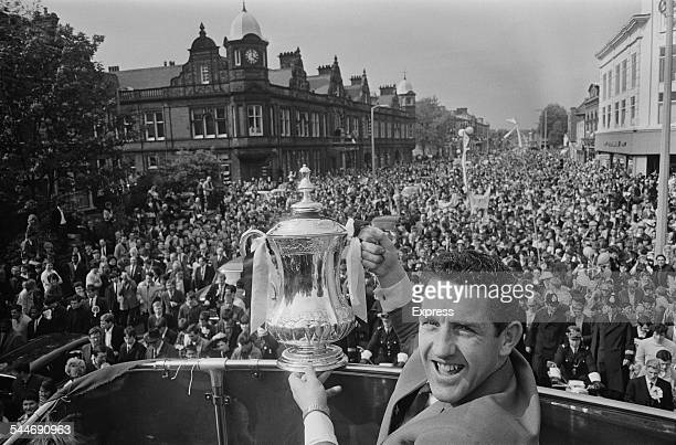 Scottish football player Dave Mackay of Tottenham Hotspur FC lifting the FA Cup during Tottenham's street procession after his side defeat Chelsea 21...