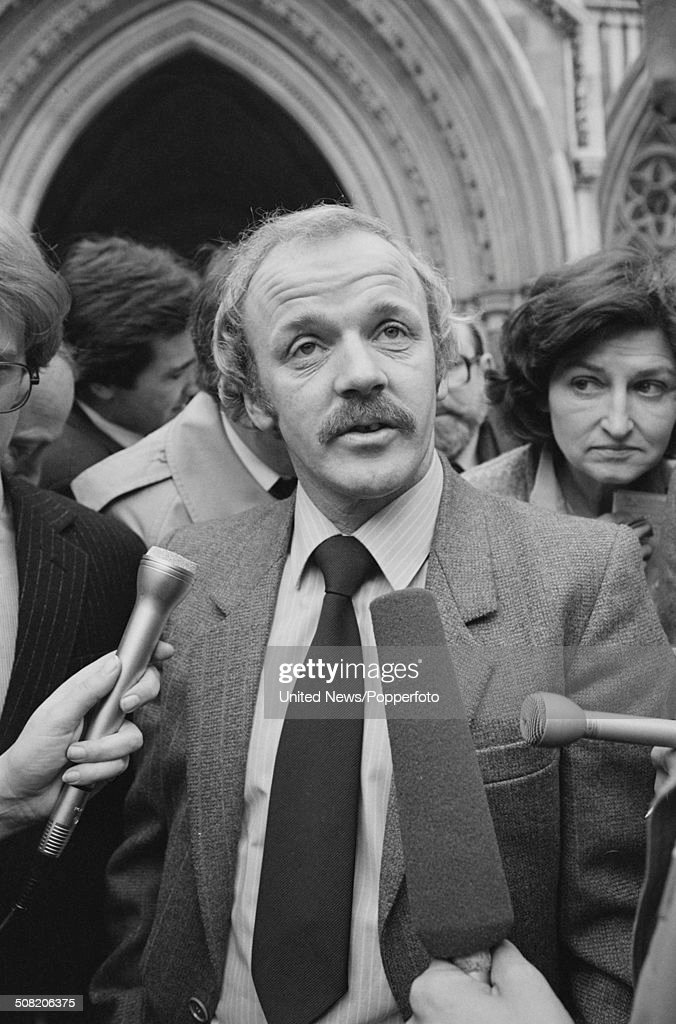 Scottish footballer Billy Bremner pictured with journalists outside the Royal Courts of Justice during his libel action against the Sunday People...
