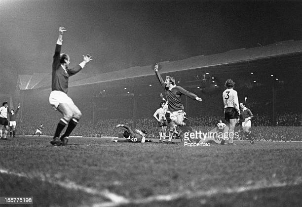 Scottish footballer Dennis Law of Manchester United celebrates a goal circa 1970 On the left is teammate Bobby Charlton