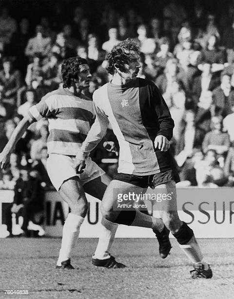 Scottish footballer Frank McLintock of Queens Park Rangers FC and Bob Hatton of Birmingham City FC in action during a match at Rangers' Loftus Road...