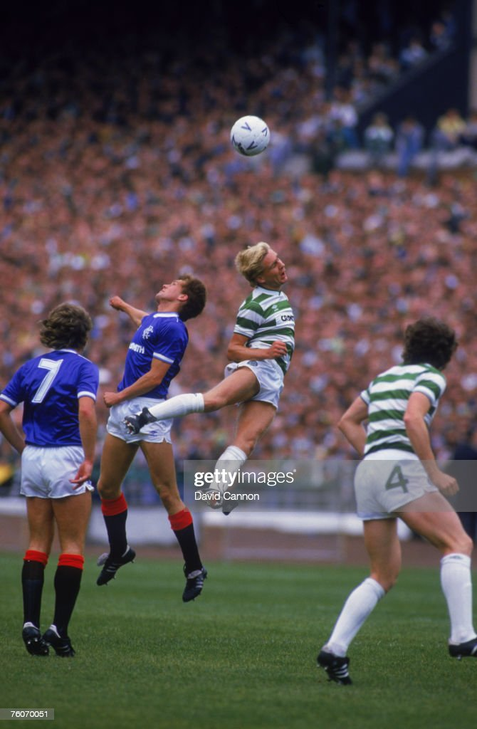 Scottish footballers Dougie Bell of Rangers (centre, left) and Peter Grant of Celtic (centre, right) compete for the ball during a Scottish Premier League match at Celtic Park, Glasgow, August 1985. The match ended in a 1-1 draw.