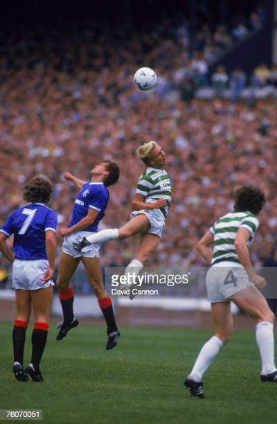 Scottish footballers Dougie Bell of Rangers and Peter Grant of Celtic compete for the ball during a Scottish Premier League match at Celtic Park...
