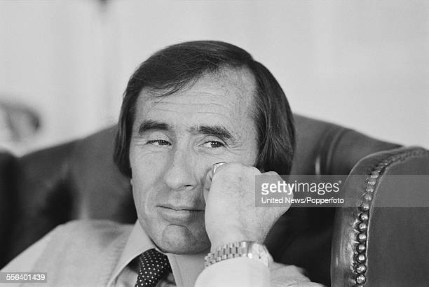 Scottish former Formula One racing driver Jackie Stewart pictured sitting in an armchair at the Grosvenor House Hotel in London on 22nd September 1983