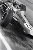 Scottish Formula One racing driver Jim Clark winner of two World Championships in 1963 and 1965 driving his Lotus racing car at the Monaco Grand Prix...