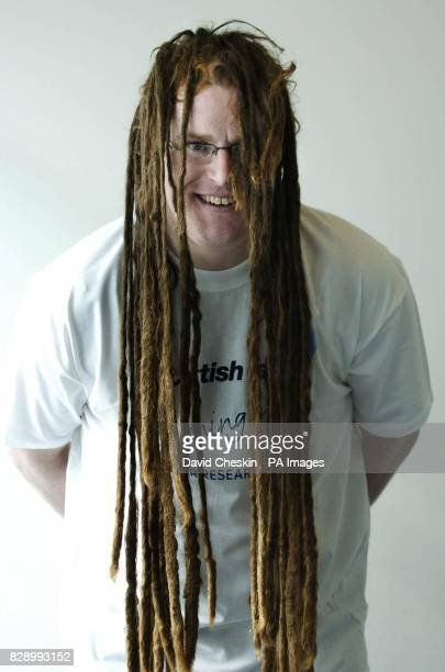 Scottish gas worker Ian Barron after having his 15yearold dreadlocks cut off by reknowned hairdresser Charlie Miller to raise money for Cancer...
