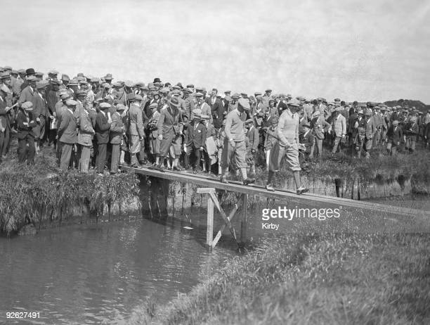 Scottish golfer MacDonald Smith crosses the burn at Prestwick Golf Club in Scotland during the Open Golf Championship 26th June 1925