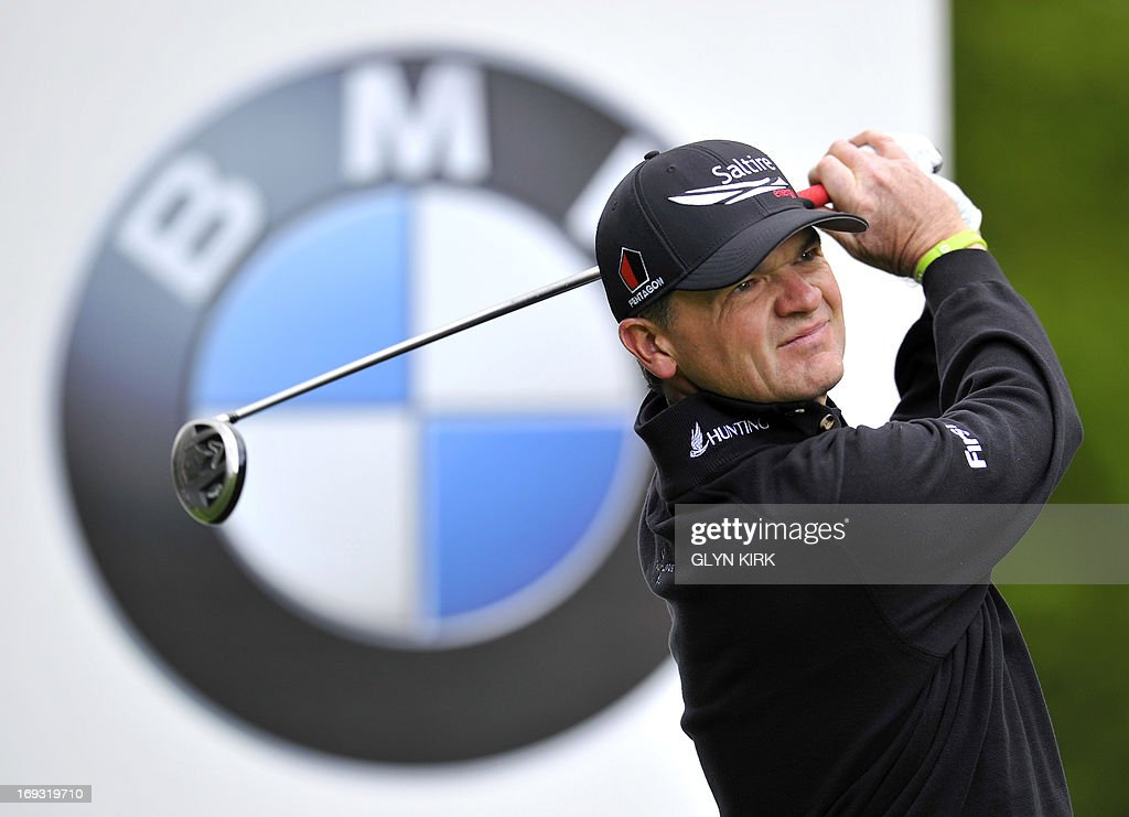 Scottish golfer Paul Lawrie watches his drive from the 4th tee during the first round of the PGA Championship at Wentworth Golf Club in Surrey on May 23, 2013. AFP PHOTO/GLYN KIRK