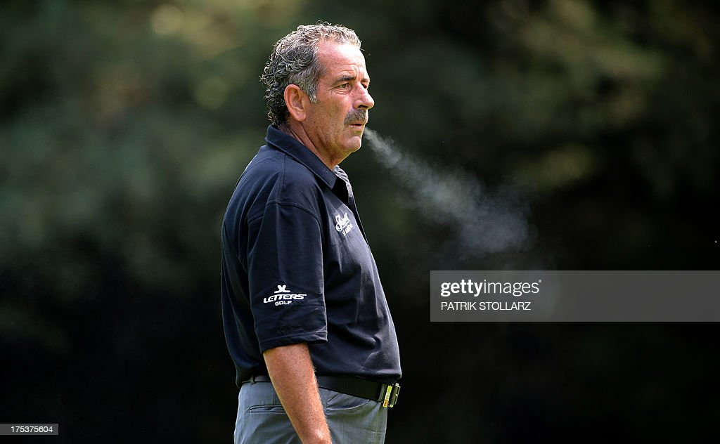 Scottish golfer Sam Torrance smokes a cigarette during the second round of the Berenberg Bank Masters Cologne European Senior Tour at the Golf and Country Club Cologne in Bergisch Gladbach near Cologne, western Germany on August 3, 2013.
