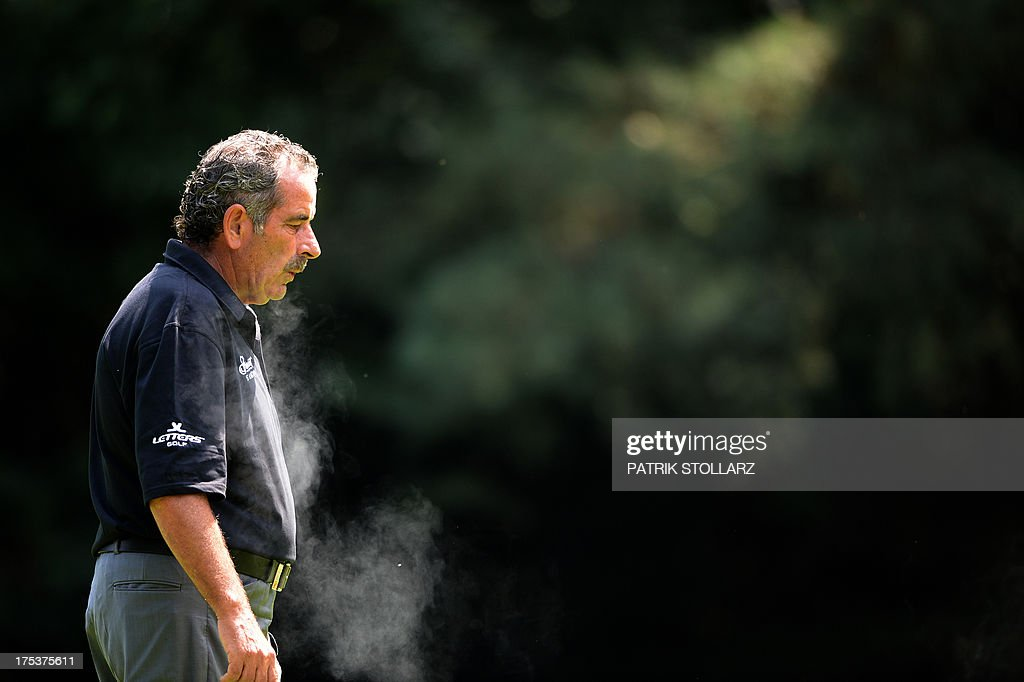 Scottish golfer Sam Torrance smokes a cigarette during the second round of the Berenberg Bank Masters Cologne European Senior Tour at the Golf and Country Club Cologne in Bergisch Gladbach near Cologne, western Germany on August 3, 2013. AFP PHOTO / PATRIK STOLLARZ