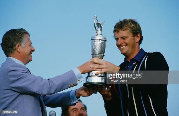 Scottish golfer Sandy Lyle receives the British Open trophy from Angus Lloyd Captain of St George's at the Royal St George's Golf Club July 1985