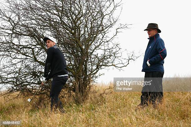 Scottish golfer Sandy Lyle watches over TJ Perenara of the All Blacks during a round of golf at the Gullane Golf Course on November 12 2014 in...