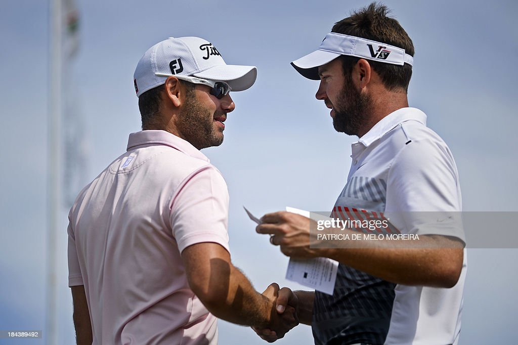 Scottish golfer Scott Jamieson greets British golfer Paul Waring at the 1st hole during the last day of the Portugal Masters golf tounament at...