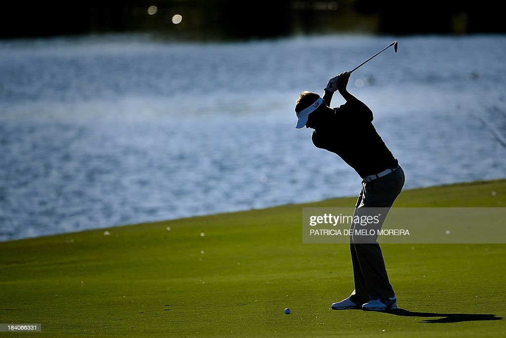 Scottish golfer Scott Jamieson plays a shot from the fairway to the 14th during the second day of the Portugal Masters golf tournament at Victoria...