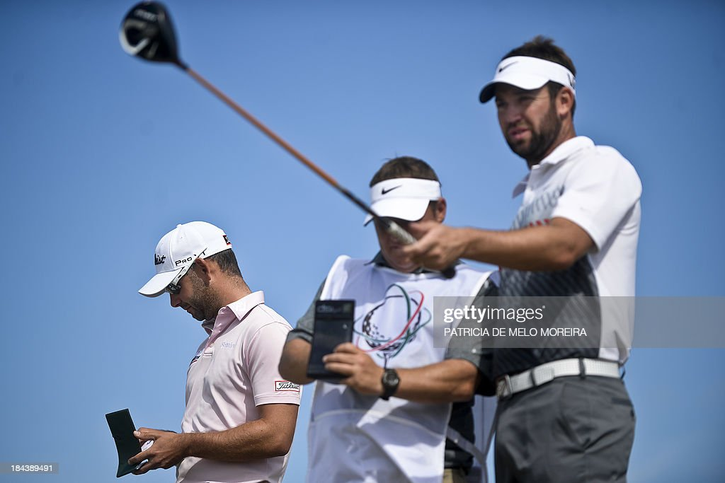 Scottish golfer Scott Jamieson speaks to his caddie as British golfer Paul Waring takes notes at the 1st hole during the last day of the Portugal...